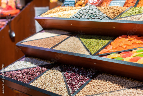 Poster Zanzibar counter with rows of different grains in the market store f