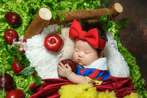 Cuadros en Lienzo The cute baby is sleeping and looks very comfortable.