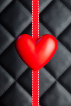 Red Heart And Ribbon On Black Background