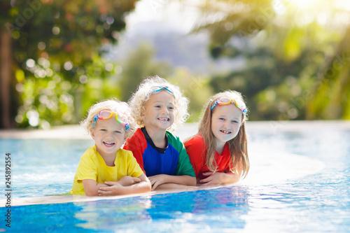 Kids in swimming pool. Children swim. Family fun.