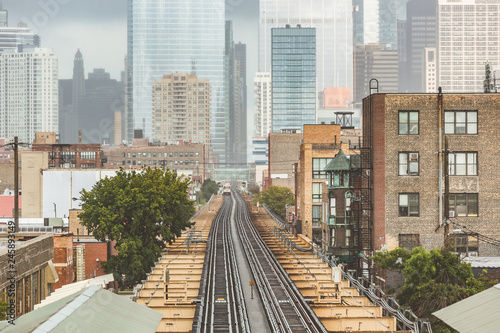 Photo  Chicago, railway view with city skyscrapers on background