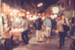 Abstract blur image of flea market and people at night with bokeh for background usage.