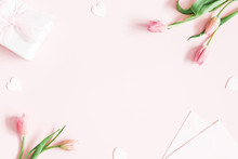 Valentine's Day Composition. Tulip Flowers, Envelope On Pastel Pink Background. Valentines Day, Mothers Day, Womens Day Concept. Flat Lay, Top View, Copy Space