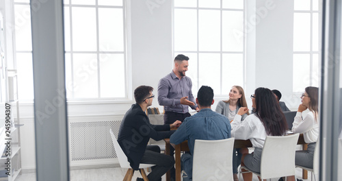 Valokuva  Group of business people having brainstorm meeting