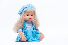 Doll With Blond Hair In A Blu...