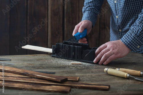 Fototapeta  carpenter working with tools on wooden background