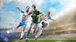 Leinwandbild Motiv Soccer players in action on the day grand stadium background panorama