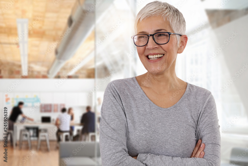 Fototapety, obrazy: Happy smiling business woman in an office. Teamwork , success concept