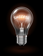 Transparent Glowing  Light Bulb On A Dark Background With The Word Success Instead Of A Tungsten Filament. Highly Realistic Illustration.