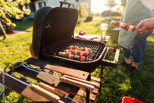 Close up of grilled vegetables and meat on sticks on grill. Family gathering concept.