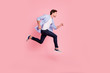 canvas print picture - Full length side profile body size photo of jumping high he his him handsome run fast  look empty space need win victory winner wearing casual jeans checkered plaid shirt isolated on rose background