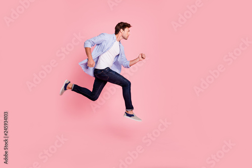 Fotografiet  Full length side profile body size photo of jumping high he his him handsome run