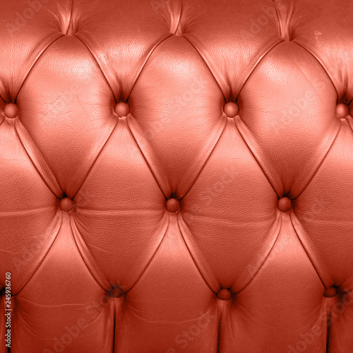 Obrazy wieloczęściowe Living Coral color of the Year 2019 Leather Upholstery Background with coral in trendy color