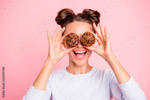 Foto auf AluDibond Brot Close-up portrait of nice lovely attractive cheerful cheery girl holding in hands two cakes closing covering eyes opened mouth isolated over pink pastel background