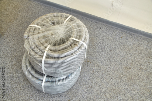 Foto  two rolls of corrugated pipe