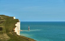 A View Of Beachy Head Lighthouse On The East Sussex Coast.