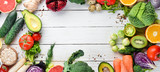 Fresh vegetables and fruits on a white wooden background. Healthy Organic Food. Top view. Free copy space.