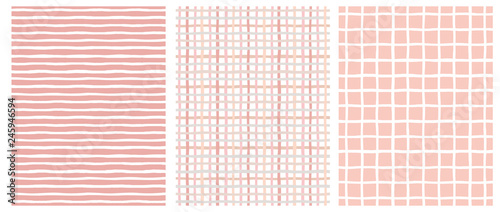 plakat Set of 3 Hand Drawn Irregular Geometric Patterns. Horizontal White Stripes on a Pink Background. Pink and Beige Grid on a White. White Grid on a Pink. Cute Infantile Repeatable Design.