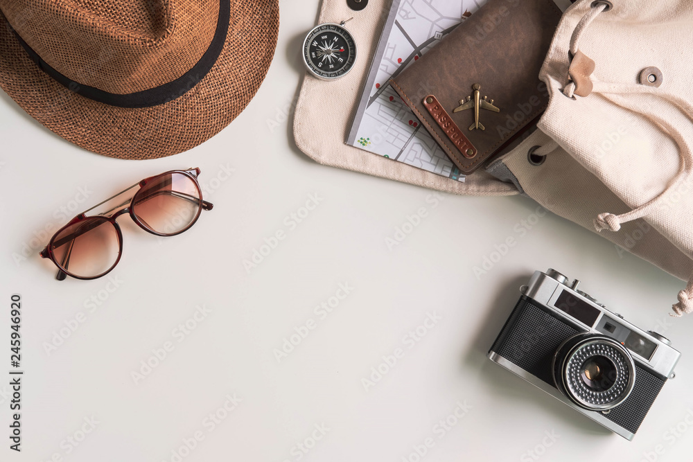 Fototapeta Retro camera with travel accessories and items on white background with copy space, Travel concept