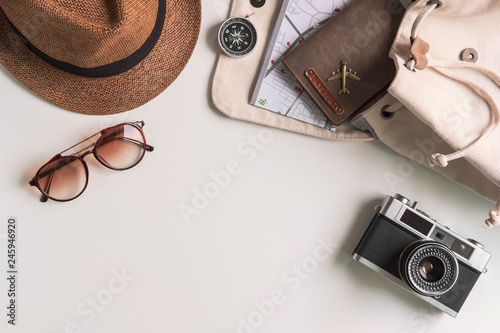 Fototapeta Retro camera with travel accessories and items on white background with copy space, Travel concept obraz