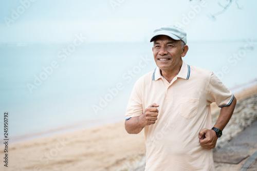 mature asian man doing sport outdoor