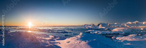 Spoed Foto op Canvas Antarctica Sunset panoramic view of snow covered Antarctic land. Picturesque South Pole scenery. Beauty of the untouched nature. The wilderness landscape. Travel background. Holiday, hiking, sport, recreation