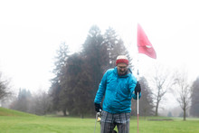 Man Standing On A Golf Course ...