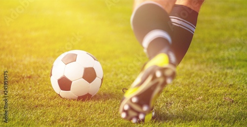 Running soccer player in football Tablou Canvas