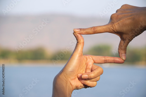 Canvastavla  Hands of person making frame distance or symbol in nature.