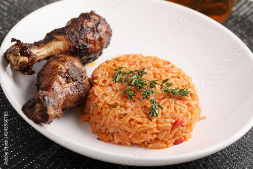 Deurstickers Assortiment Nigerian Jollof Rice with chicken thigh