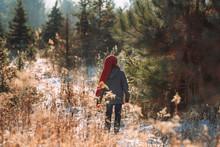 Boy Walking In A Field In Wint...