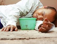 Homeless Man Sleeping And Sadness On Walking Street.