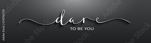 Fototapeta DARE TO BE YOU brush calligraphy banner on black background obraz