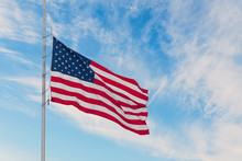 American Flag On The Sunset Sky Background