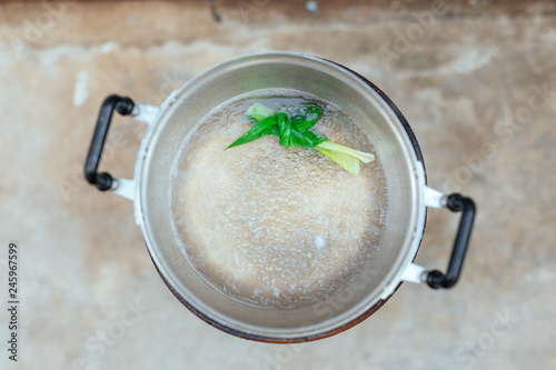 Top view of the boiling pot with a knot of Thai herbs Slika na platnu