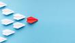 Leinwanddruck Bild - One blue paper plane leading group of white ones