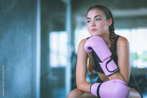 Fit beautiful young woman muay thai boxer exercise class in a gym Fototapete