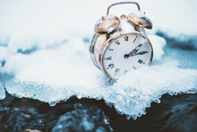 Frozen Time. A Clock On An Ice...