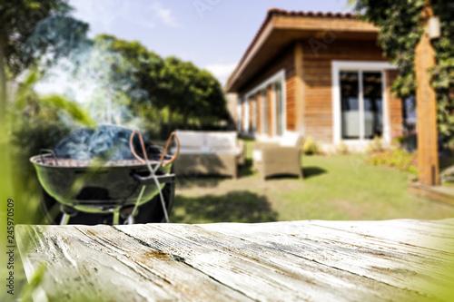 Carta da parati Table background and grill in garden