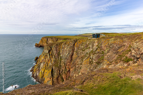 Fotografie, Obraz  Building perched on the edge of a cliff overlooking the sea