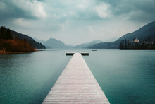 Wooden Pier With Clear Lake In...