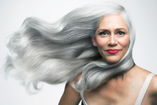 Beautiful Woman With Her Long, Silvery, Grey Hair Blowing Sideways, Portrait.