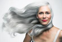 Beautiful Woman With Her Long, Silvery, Grey Hair Blowing Sideways, Portrait.