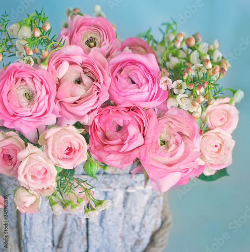 Photo sur Toile Fleur Close-up floral composition with a pink Ranunculus flowers . Beautiful bouquet of a spring flowers.
