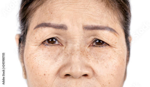 Valokuva  close up skin wrinkle and freckles of old asian woman face