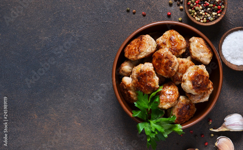 Photo  Meat balls with spices on a concrete background. View from above.