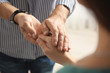 Man comforting woman on light background, closeup of hands. Help and support concept