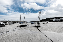 Boats At Low Tide With Blue Sk...