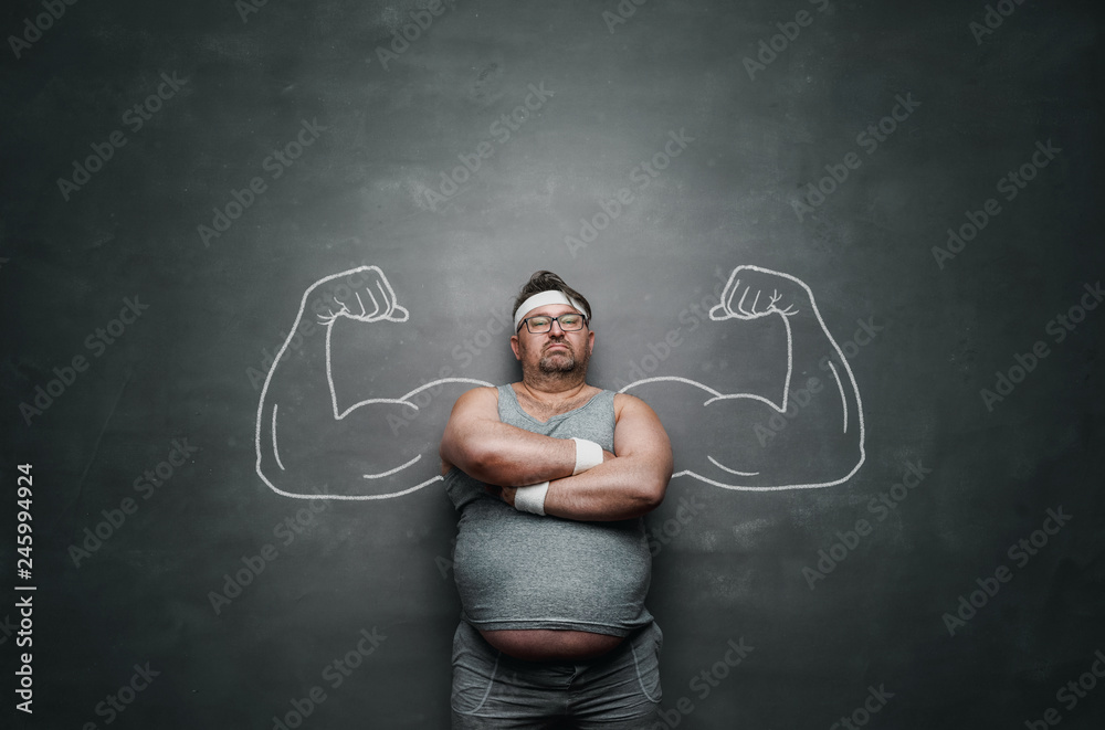 Fototapeta Funny sports nerd with huge muscle arms drawn on the gray background with copy space