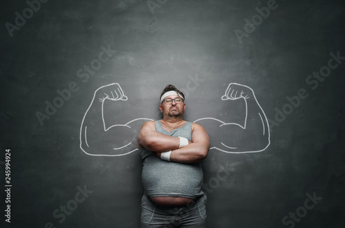 Funny sports nerd with huge muscle arms drawn on the gray background with copy s Fototapeta